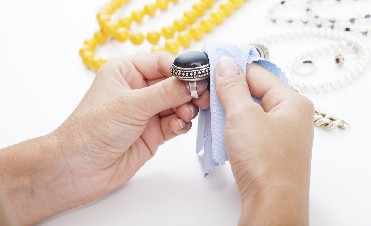 Polishing silver jewellery with a cloth